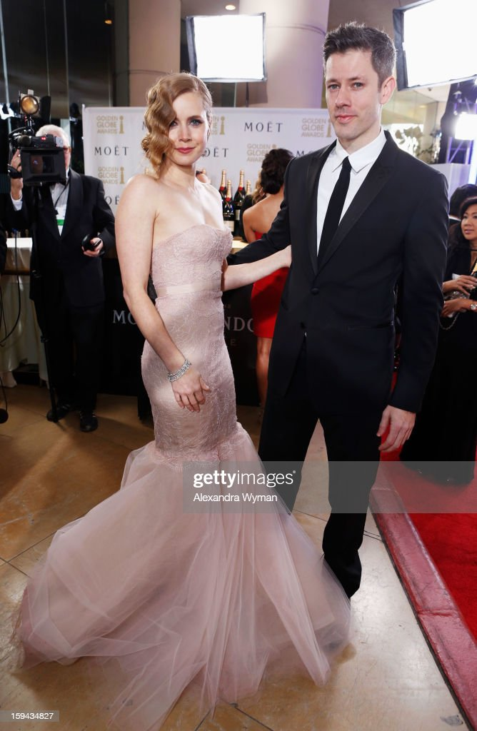 Actress <a gi-track='captionPersonalityLinkClicked' href=/galleries/search?phrase=Amy+Adams&family=editorial&specificpeople=213938 ng-click='$event.stopPropagation()'>Amy Adams</a> and Darren Le Gallo arrive at the 70th Annual Golden Globe Awards held at The Beverly Hilton Hotel on January 13, 2013 in Beverly Hills, California.