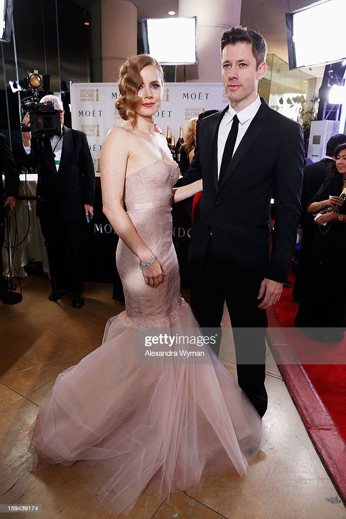 Actress Amy Adams and Darren Le Gallo arrives at the 70th Annual Golden Globe Awards held at The Beverly Hilton Hotel on January 13, 2013 in Beverly Hills, California.