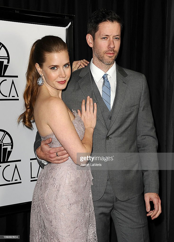 Actress <a gi-track='captionPersonalityLinkClicked' href=/galleries/search?phrase=Amy+Adams&family=editorial&specificpeople=213938 ng-click='$event.stopPropagation()'>Amy Adams</a> and husband <a gi-track='captionPersonalityLinkClicked' href=/galleries/search?phrase=Darren+Le+Gallo&family=editorial&specificpeople=866858 ng-click='$event.stopPropagation()'>Darren Le Gallo</a> attend the 38th annual Los Angeles Film Critics Association Awards at InterContinental Hotel on January 12, 2013 in Century City, California.