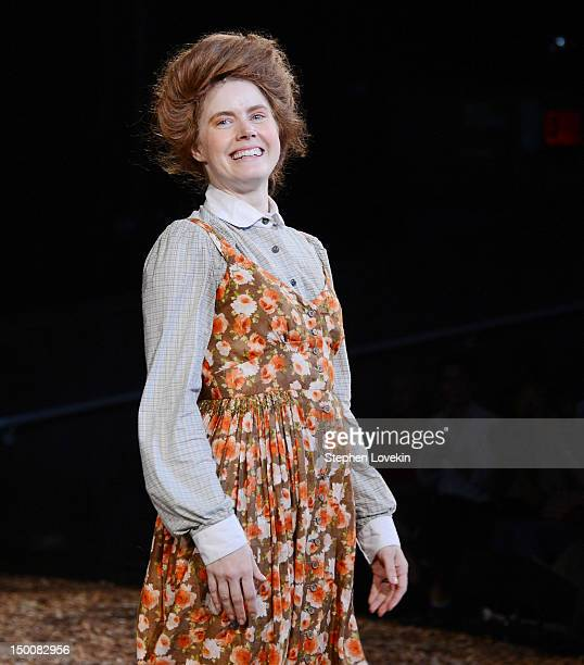 Actress Amy Adams appears on stage during the curtain call for the 'Into The Woods' opening night celebration at the Delacorte Theater on August 9...