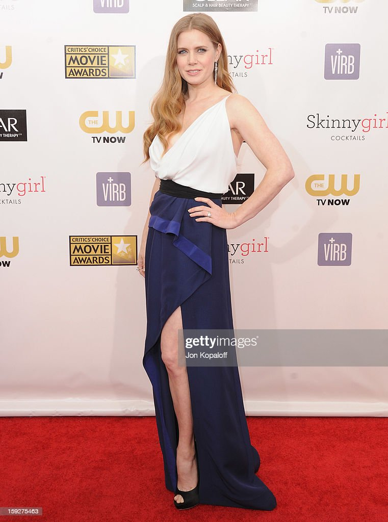 Actress <a gi-track='captionPersonalityLinkClicked' href=/galleries/search?phrase=Amy+Adams&family=editorial&specificpeople=213938 ng-click='$event.stopPropagation()'>Amy Adams</a> arrives at the 18th Annual Critics' Choice Movie Awards at Barker Hangar on January 10, 2013 in Santa Monica, California.