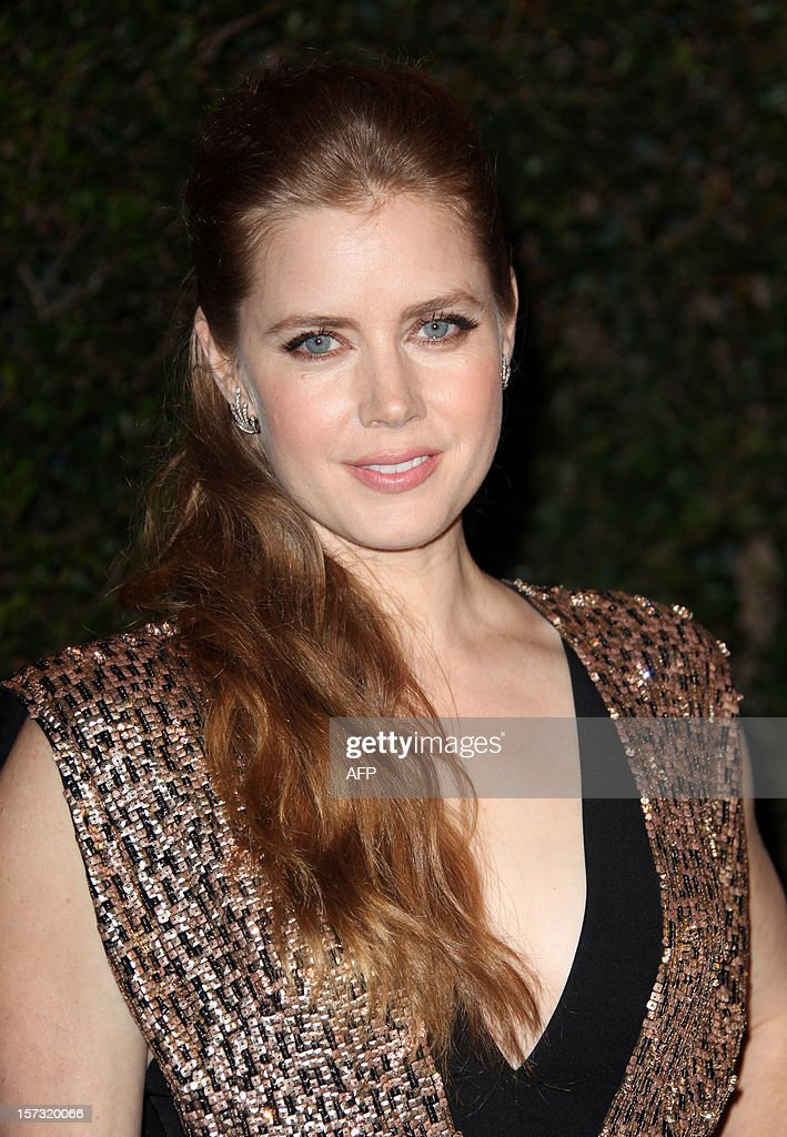 Actress Amy Adams arrives at the 2012 Governors Awards at the Ray Dolby Ballroom at Hollywood & Highland Center in Hollywood, California on December 1, 2012. The Board of Governors of the Academy of Motion Picture Arts and Sciences (AMPAS) is presenting the Jean Hersholt Humanitarian Award to Jeffery Katzenberg, and Honorary Awards to stunt performer Hal Needham, documentarian D.A. Pennebaker and arts advocate George Stevens Jr.at the inaugural Governors Awards event. AFP PHOTO / Krista KENNELL