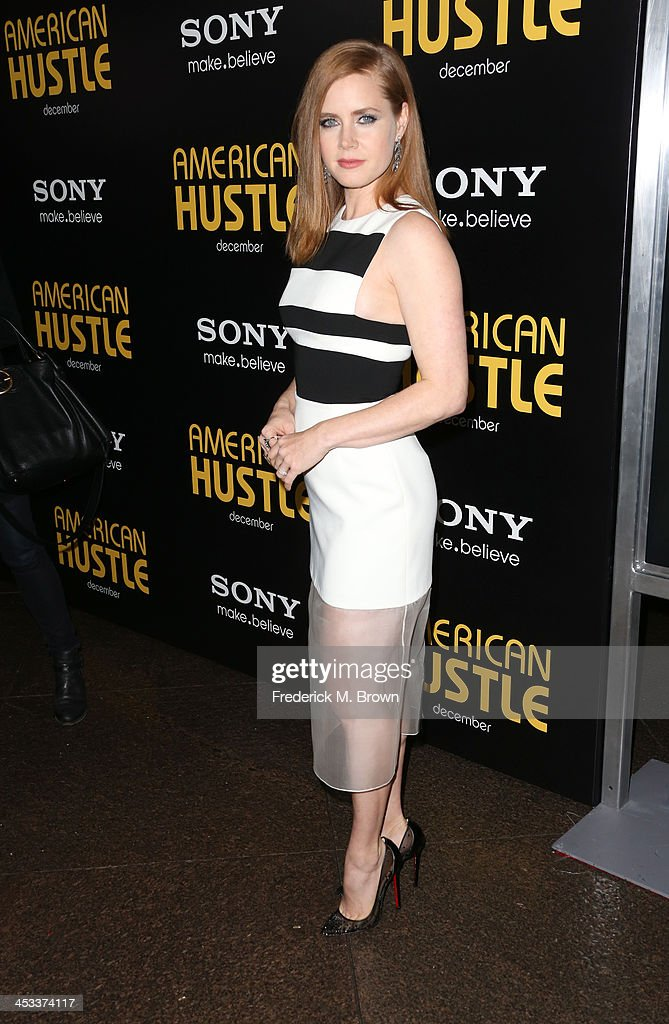 Actress <a gi-track='captionPersonalityLinkClicked' href=/galleries/search?phrase=Amy+Adams&family=editorial&specificpeople=213938 ng-click='$event.stopPropagation()'>Amy Adams</a> arrives at the special screening of Columbia Pictures and Annapurna Pictures' 'American Hustle' at the Directors Guild Theatre on December 3, 2013 in Los Angeles, California.