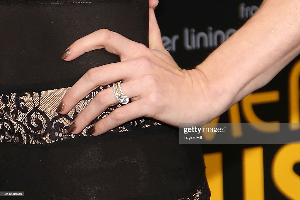 Actress Amy Adams (engagement ring detail) attends the 'American Hustle' screening at Ziegfeld Theater on December 8, 2013 in New York City.