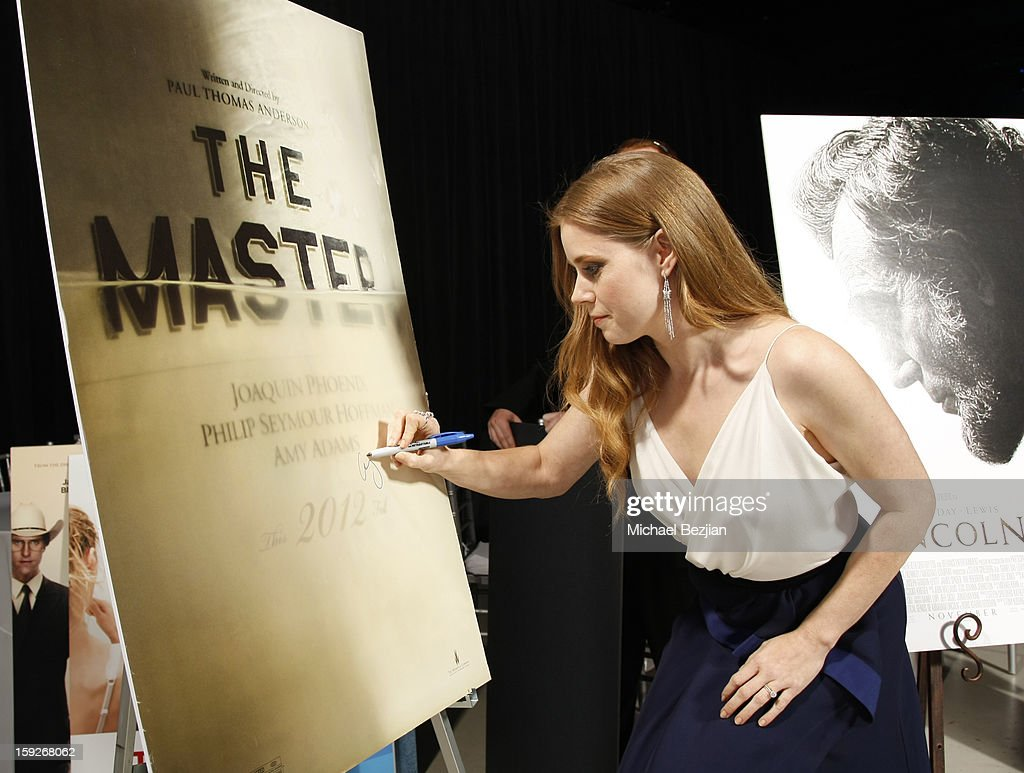 Actress <a gi-track='captionPersonalityLinkClicked' href=/galleries/search?phrase=Amy+Adams&family=editorial&specificpeople=213938 ng-click='$event.stopPropagation()'>Amy Adams</a> attends the poster signing event for charity during the Critics' Choice Movie Awards 2013 at Barkar Hangar on January 10, 2013 in Santa Monica, California.