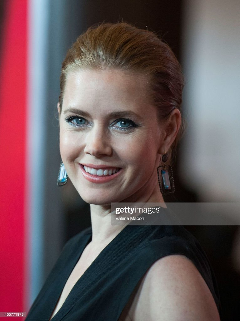 Actress <a gi-track='captionPersonalityLinkClicked' href=/galleries/search?phrase=Amy+Adams&family=editorial&specificpeople=213938 ng-click='$event.stopPropagation()'>Amy Adams</a> attends the premiere of Warner Bros. Pictures' 'Her.' at DGA Theater on December 12, 2013 in Los Angeles, California.