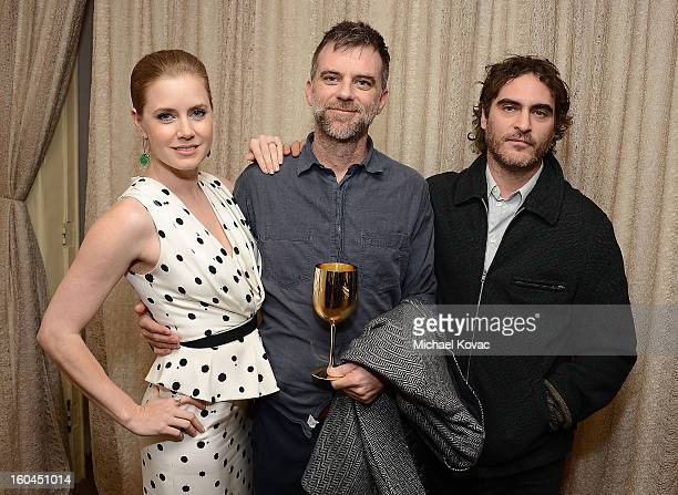 Actress Amy Adams director Paul Thomas Anderson and actor Joaquin Phoenix visit The Moet Chandon Lounge at The Santa Barbara International Film...