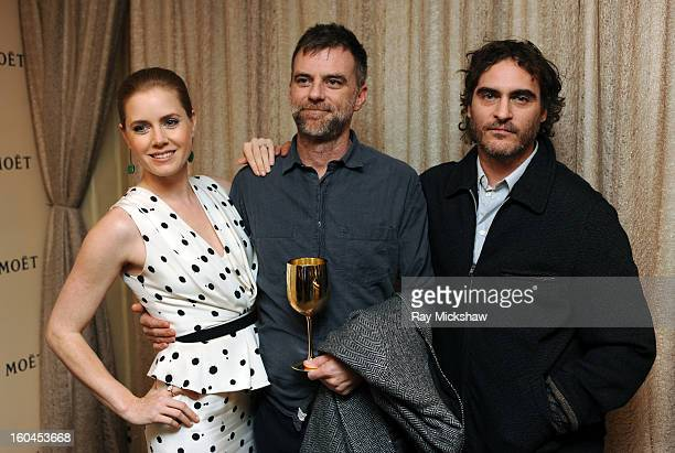 Actress Amy Adams director Paul Thomas Anderson and actor Joaquin Phoenix attend the Cinema Vanguard Award at the Santa Barbara International Film...