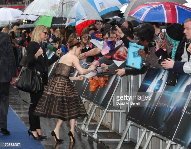 Actress Amy Adams signs autographs for fans as she attends the UK Premiere of 'Man of Steel' at Odeon Leicester Square on June 12 2013 in London...