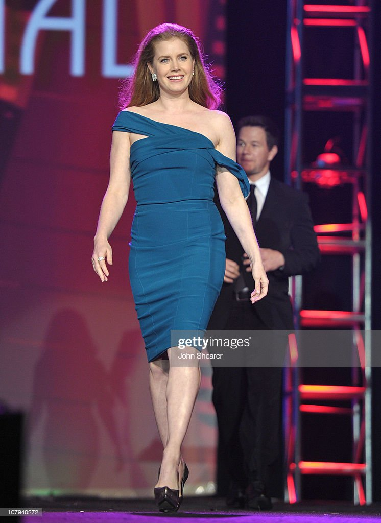 Actress <a gi-track='captionPersonalityLinkClicked' href=/galleries/search?phrase=Amy+Adams&family=editorial&specificpeople=213938 ng-click='$event.stopPropagation()'>Amy Adams</a> walks onstage during the 22nd Annual Palm Springs International Film Festival Awards Gala at the Palm Springs Convention Center on January 8, 2011 in Palm Springs, California.