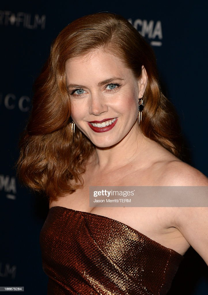 Actress <a gi-track='captionPersonalityLinkClicked' href=/galleries/search?phrase=Amy+Adams&family=editorial&specificpeople=213938 ng-click='$event.stopPropagation()'>Amy Adams</a>, wearing Gucci, attends the LACMA 2013 Art + Film Gala honoring Martin Scorsese and David Hockney presented by Gucci at LACMA on November 2, 2013 in Los Angeles, California.