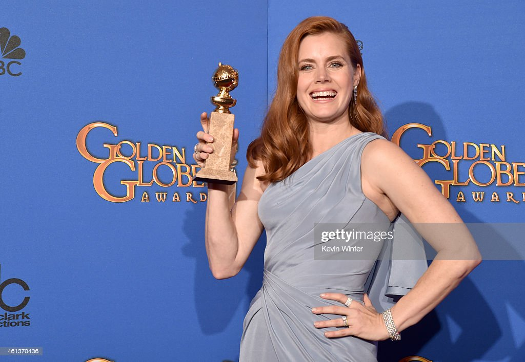 Actress <a gi-track='captionPersonalityLinkClicked' href=/galleries/search?phrase=Amy+Adams&family=editorial&specificpeople=213938 ng-click='$event.stopPropagation()'>Amy Adams</a>, winner of Best Actress in a Motion Picture – Musical or Comedy for 'Big Eyes,' poses in the press room during the 72nd Annual Golden Globe Awards at The Beverly Hilton Hotel on January 11, 2015 in Beverly Hills, California.