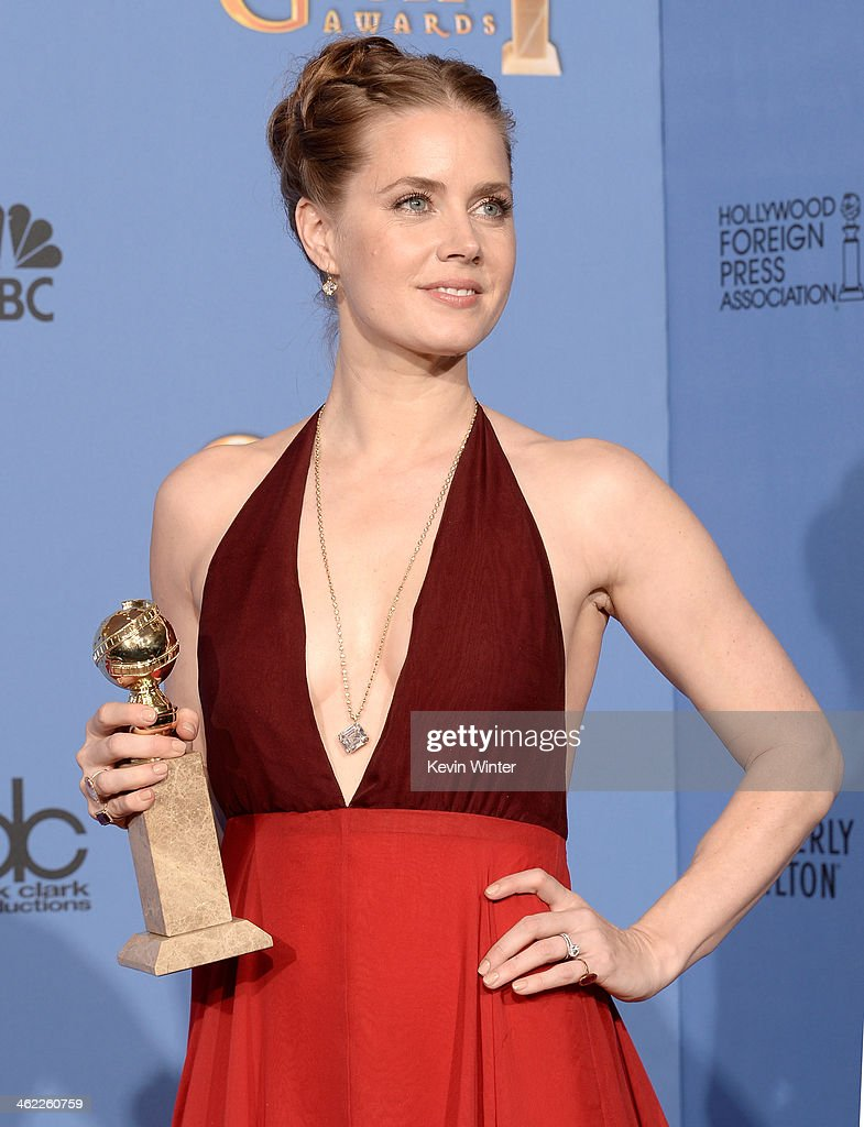 Actress Amy Adams winner of Best Actress in a Motion Picture Musical or Comedy for 'American Hustle' poses in the press room during the 71st Annual...