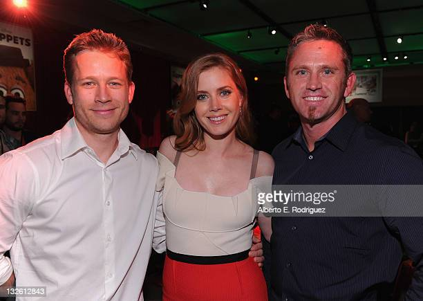Actress Amy Adams with brothers attends Walt Disney Presents The Premiere of 'The Muppets' after party at El Capitan Theatre on November 12 2011 in...