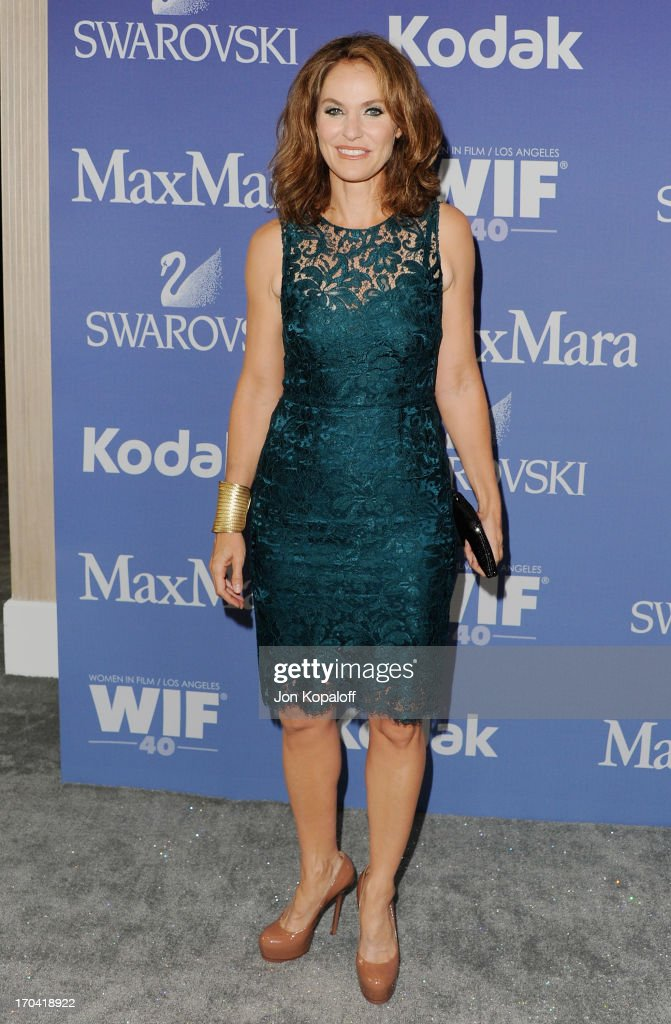 Actress <a gi-track='captionPersonalityLinkClicked' href=/galleries/search?phrase=Amy+Brenneman&family=editorial&specificpeople=209217 ng-click='$event.stopPropagation()'>Amy Brenneman</a> arrives at the 2013 Women In Film's Crystal + Lucy Awards at The Beverly Hilton Hotel on June 12, 2013 in Beverly Hills, California.