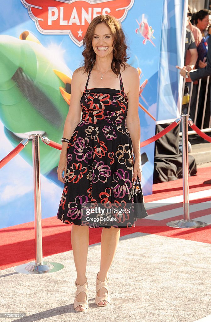Actress Amy Brenneman arrives at the Los Angeles premiere of 'Planes' at the El Capitan Theatre on August 5, 2013 in Hollywood, California.