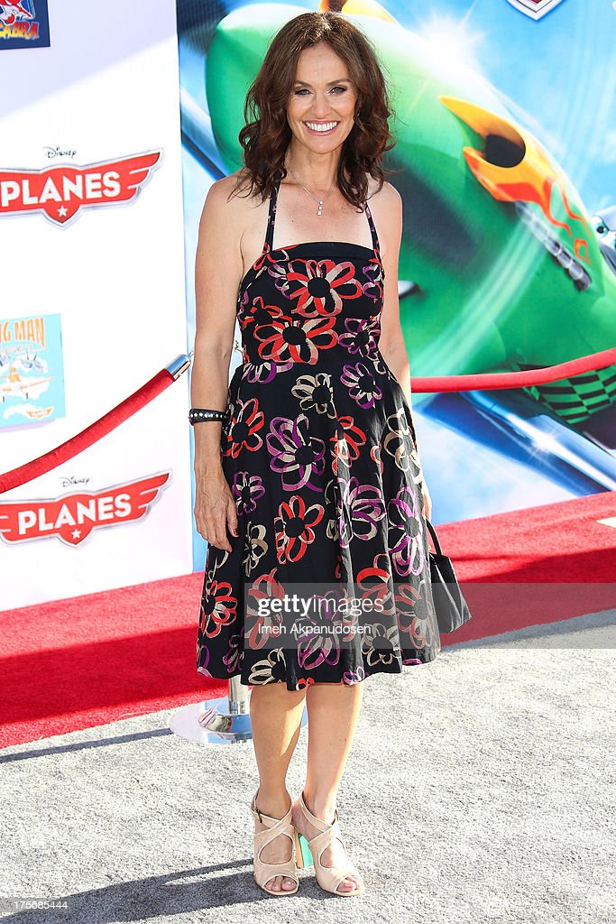 Actress Amy Brenneman attends the premiere of Disney's 'Planes' at the El Capitan Theatre on August 5, 2013 in Hollywood, California.
