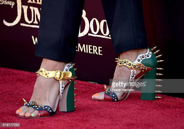 Actress Amy Brenneman shoe detail attends the premiere of Disney's 'The Jungle Book' at the El Capitan Theatre on April 4 2016 in Hollywood California