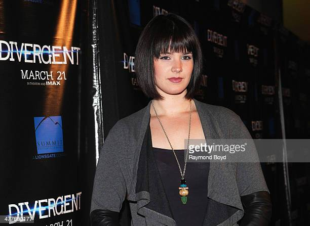 Actress Amy Newbold poses for photos on the red carpet for the 'Divergent' screening at Kerasotes Showplace ICON on March 4 2014 in Chicago Illinois