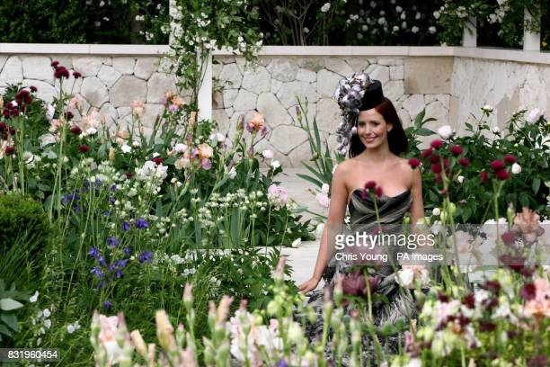 Actress Amy Nuttall wears a Jasper Conran dress and a Cozmo hat in the LaurentPerrier Garden at the Chelsea Flower Show in west London