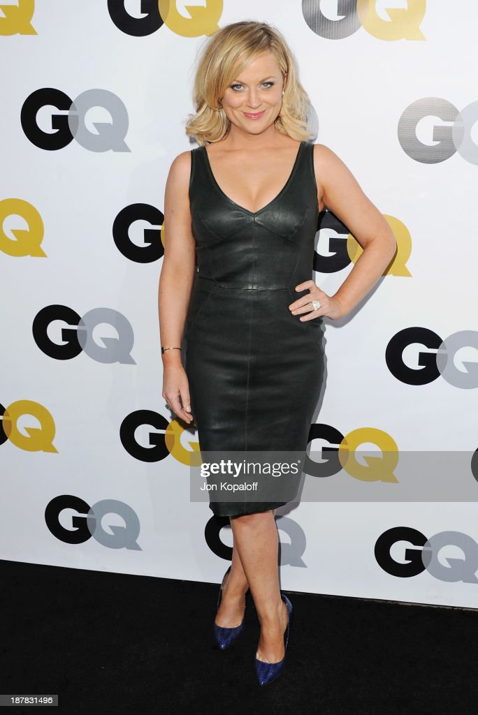 Actress Amy Poehler arrives at GQ Celebrates The 2013 'Men Of The Year' at The Wilshire Ebell Theatre on November 12, 2013 in Los Angeles, California.