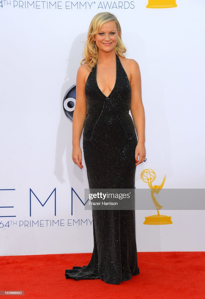 Actress <a gi-track='captionPersonalityLinkClicked' href=/galleries/search?phrase=Amy+Poehler&family=editorial&specificpeople=228430 ng-click='$event.stopPropagation()'>Amy Poehler</a> arrives at the 64th Annual Primetime Emmy Awards at Nokia Theatre L.A. Live on September 23, 2012 in Los Angeles, California.