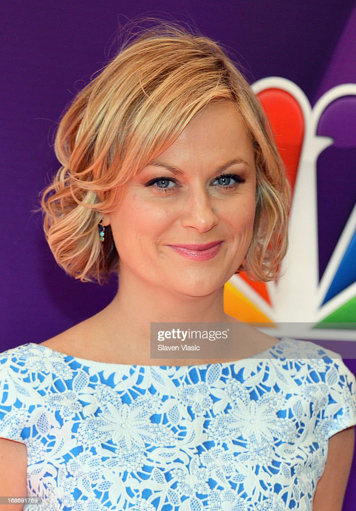 Actress <a gi-track='captionPersonalityLinkClicked' href=/galleries/search?phrase=Amy+Poehler&family=editorial&specificpeople=228430 ng-click='$event.stopPropagation()'>Amy Poehler</a> attends 2013 NBC Upfront Presentation Red Carpet Event at Radio City Music Hall on May 13, 2013 in New York City.