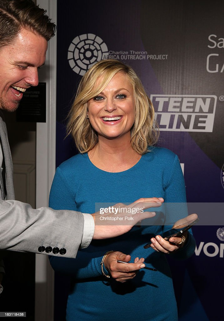 Actress <a gi-track='captionPersonalityLinkClicked' href=/galleries/search?phrase=Amy+Poehler&family=editorial&specificpeople=228430 ng-click='$event.stopPropagation()'>Amy Poehler</a> signs photo for Samsung's Signatures for Good on the Samsung Galaxy Note 3 at Variety's 5th Annual Power of Women event presented by Lifetime at the Beverly Wilshire Four Seasons Hotel on October 4, 2013 in Beverly Hills, California.