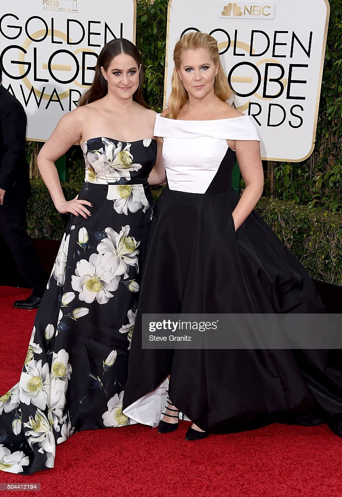Actress Amy Schumer (R) and producer Kim Caramele attend the 73rd Annual Golden Globe Awards held at the Beverly Hilton Hotel on January 10, 2016 in Beverly Hills, California.