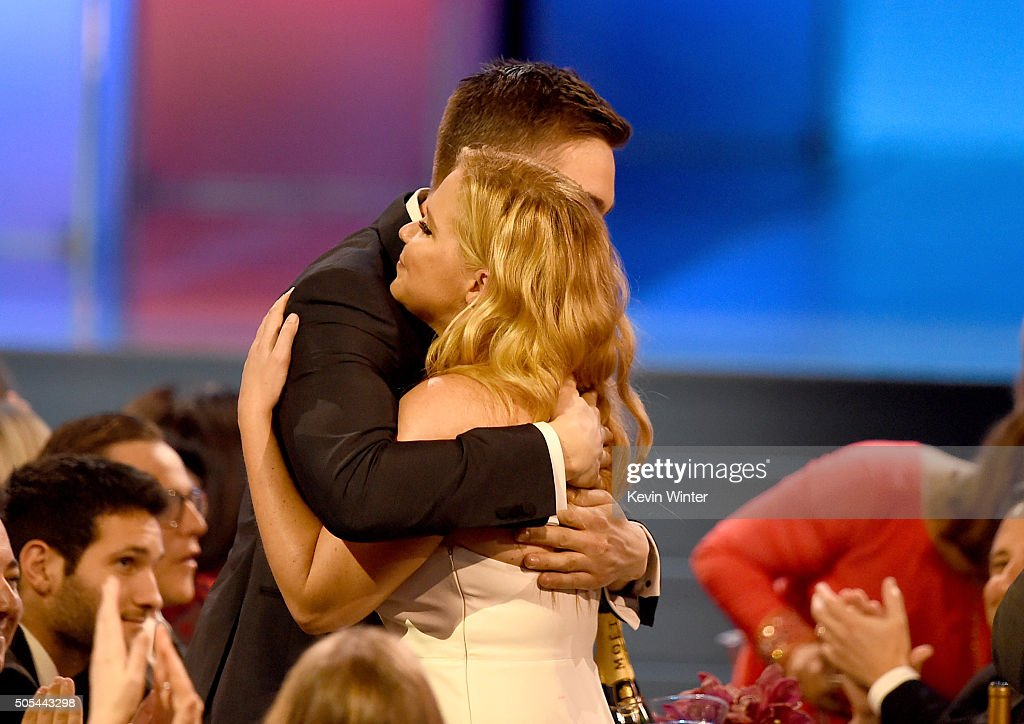 Actress Amy Schumer (R) wins Best Actress in a Comedy for 'Trainwreck' with Ben Hanisch (L) during the 21st Annual Critics' Choice Awards at Barker Hangar on January 17, 2016 in Santa Monica, California.