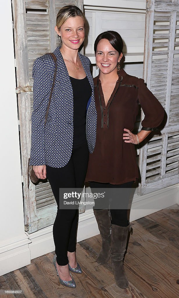 Actress <a gi-track='captionPersonalityLinkClicked' href=/galleries/search?phrase=Amy+Smart&family=editorial&specificpeople=239532 ng-click='$event.stopPropagation()'>Amy Smart</a> (L) and Kimi Culp attend a cocktail party and book signing for 'A Letter to My Dog: Notes to Our Best Friends' at Anthropologie on April 4, 2013 in Beverly Hills, California.
