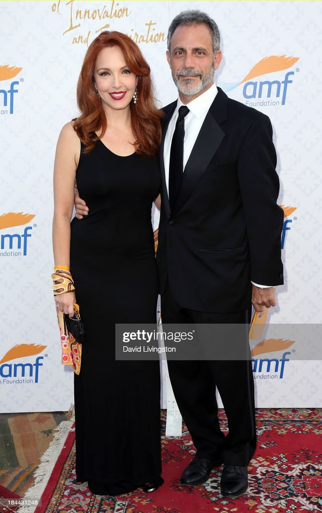 Actress Amy Yasbeck (L) and attorney Michael Plonsker attend the 10th Annual Alfred Mann Foundation Gala in the Robinsons-May Lot on October 13, 2013 in Beverly Hills, California.