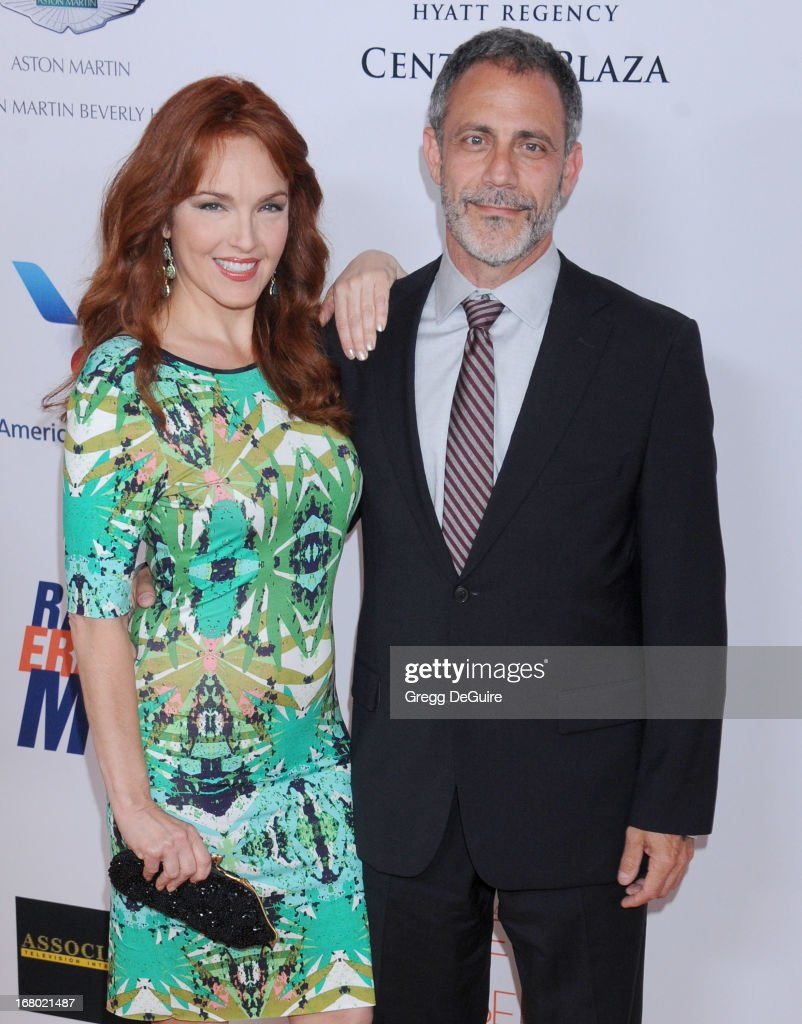 Actress Amy Yasbeck and guest arrive at the 20th Annual Race To Erase MS Gala 'Love To Erase MS' at the Hyatt Regency Century Plaza on May 3, 2013 in Century City, California.