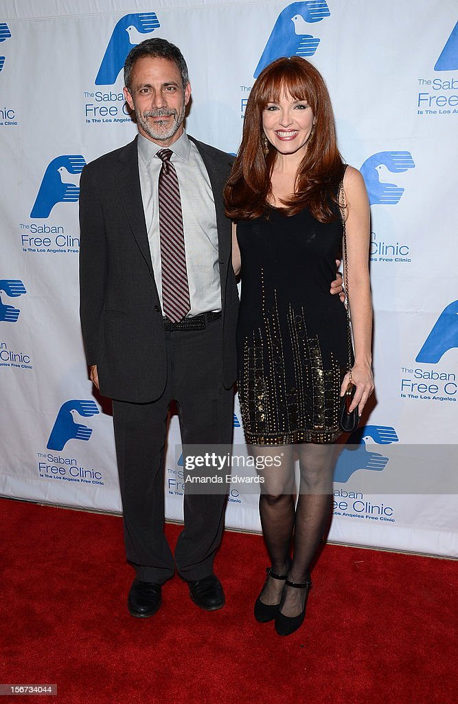 Actress Amy Yasbeck (R) arrives at the Saban Free Clinic's 36th Annual Dinner Gala at The Beverly Hilton Hotel on November 19, 2012 in Beverly Hills, California.