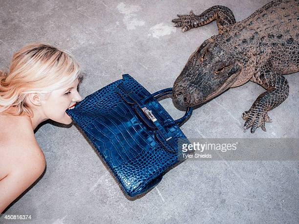 Actress Ana MulvoyTen is photographed with a crocodile and an Hermes Birkin bag for Self Assignment on May 10 2014 in Los Angeles California