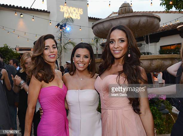 Actress Ana Ortiz executive producer Eva Longoria and actress Dania Ramirez attend the premiere of Lifetime Original Series 'Devious Maids' after...