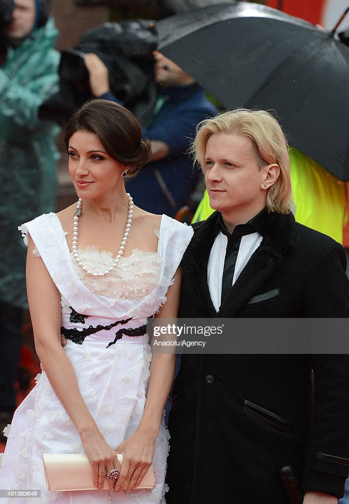 Actress Anastasiya Makeyeva and a guest pose on the red carpet during the closing ceremony of the 36th Moscow International Film Festival in Moscow...