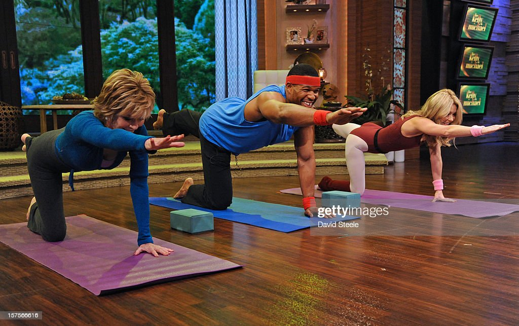 MICHAEL -12/4/12 - Actress and activist Jane Fonda teaches Kelly and Michael some yoga poses on LIVE with Kelly and Michael,' distributed by Disney-ABC Domestic Television. STRAHAN