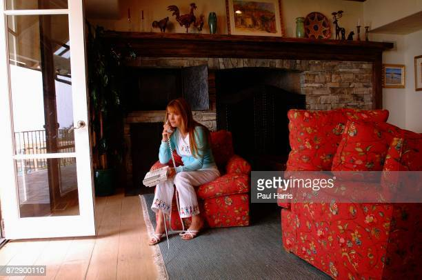 Actress and artist Jane Seymour on the phone in one of the rooms of her home overlooking the Pacific ocean on June 12 2002 in Malibu California