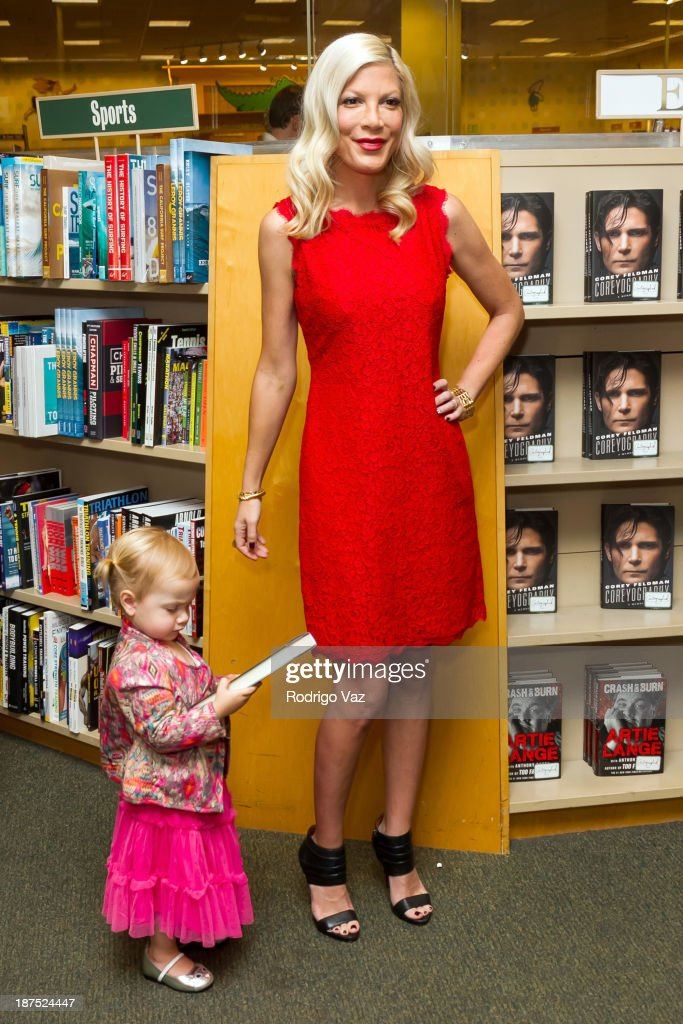 Actress and author <a gi-track='captionPersonalityLinkClicked' href=/galleries/search?phrase=Tori+Spelling&family=editorial&specificpeople=202560 ng-click='$event.stopPropagation()'>Tori Spelling</a> (R) and daughter Hattie McDermott attend as <a gi-track='captionPersonalityLinkClicked' href=/galleries/search?phrase=Tori+Spelling&family=editorial&specificpeople=202560 ng-click='$event.stopPropagation()'>Tori Spelling</a> signs copies of her new book 'Spelling It Like It Is' at Barnes & Noble bookstore at The Grove on November 9, 2013 in Los Angeles, California.