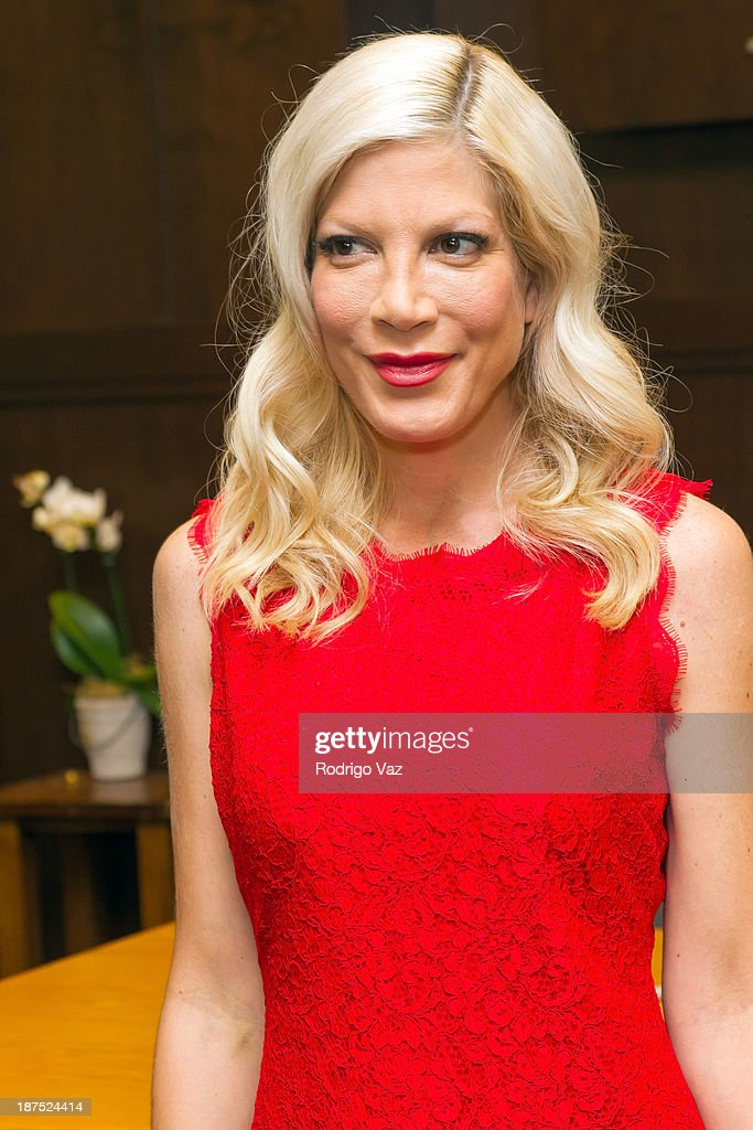 Actress and author <a gi-track='captionPersonalityLinkClicked' href=/galleries/search?phrase=Tori+Spelling&family=editorial&specificpeople=202560 ng-click='$event.stopPropagation()'>Tori Spelling</a> signs copies of her new book 'Spelling It Like It Is' at Barnes & Noble bookstore at The Grove on November 9, 2013 in Los Angeles, California.