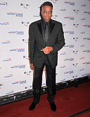 Actress and comedian Arsenio Hall poses on the red carpet during the 18th Annual Mark Twain Prize For Humor honoring Eddie Murphy at The John F...