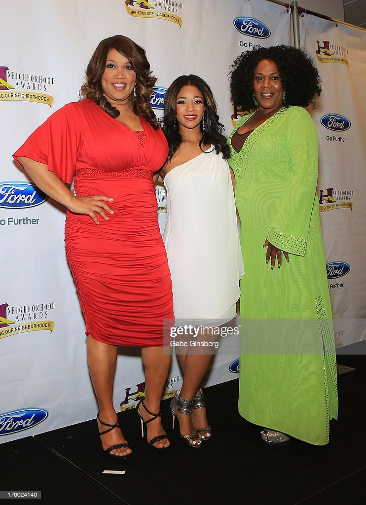 Actress and comedian Kym Whitley, her niece Tyler Whitley and Valerie Chandler arrive at the 11th annual Ford Neighborhood Awards at the MGM Grand Garden Arena on August 10, 2013 in Las Vegas, Nevada.