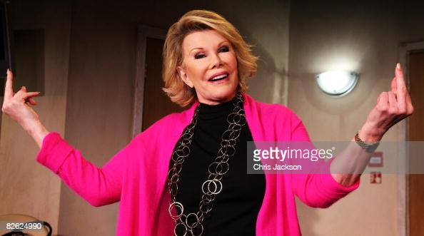Actress and comedien Joan Rivers gestures during a photocall for her new play 'A Work in Progress by a Life in Progress' at the Leicester Square...