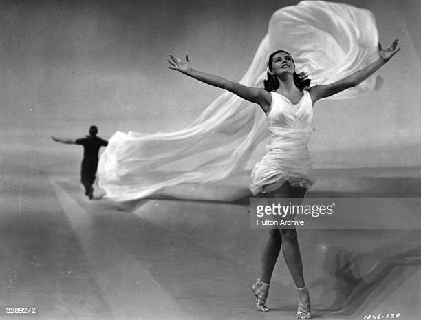 Actress and dancer Cyd Charisse as the 'Elements' in a scene from the comedy musical 'Singin' In The Rain' directed by Gene Kelly and Stanley Donen...