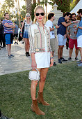Actress and designer Kate Bosworth wearing boots she designed for her Matisse shoe line and jacket by Etro during the 2015 Coachella Valley Music and...
