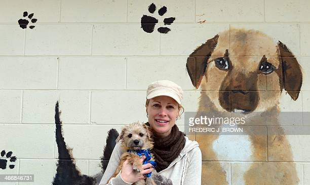Actress and director Allison Eastwood daughter of Clint Eastwood poses with a puppy up for adoption during an event at the San Bernadino City Animal...
