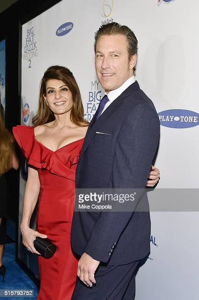 Actress and director Nia Vardalos poses alongside actor John Corbett at the premiere of My Big Fat Greek Wedding 2 on the Windex blue carpet in New...