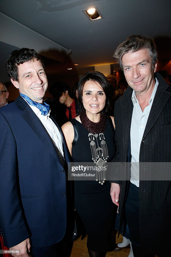 Actress and Director of the movie Ilaria Borrelli standing between her husband Co Director of the movie Guido Freddi (L) and actor of the movie Philippe Caroit (R) attend the 'Talking to the Trees - Retour a La Vie' movie screening at Cinema l'Arlequin on March 2, 2015 in Paris, France.
