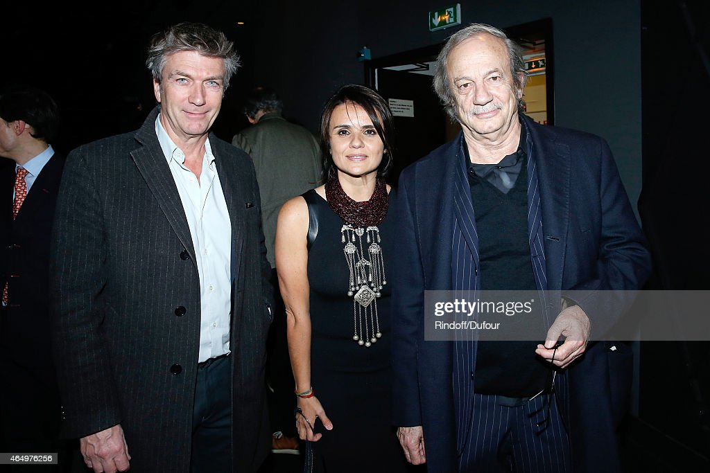 Actress and Director of the movie Ilaria Borrelli standing between actor Patrick Chesnais (R) and actor of the movie Philippe Caroit (L) attend the 'Talking to the Trees - Retour a La Vie' movie screening at Cinema l'Arlequin on March 2, 2015 in Paris, France.